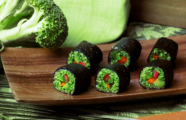 raw food rolls of buckwheat, broccoli, cucumber and pepper in a still life